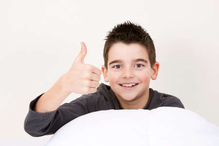 cute little boy with good expressions in bed photo