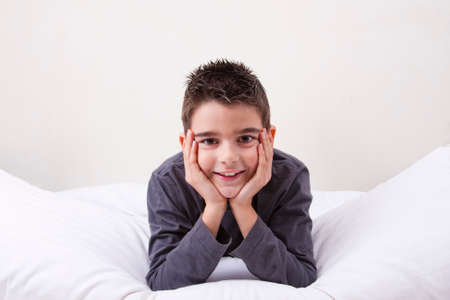 cute little boy with happy expressions in bed Stock Photo - 25563172