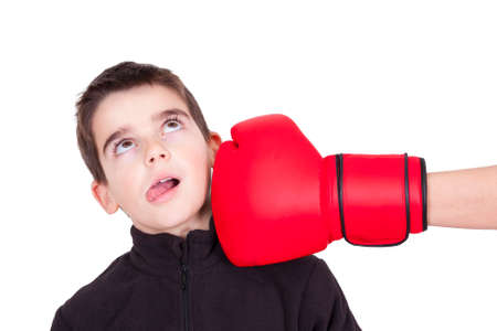 adversary: Young boy getting punched with boxing glove Stock Photo