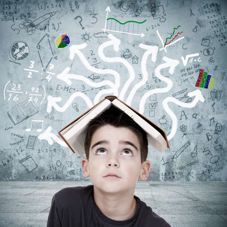 boy with book on his head overwhelmed by the chaos of the subjects