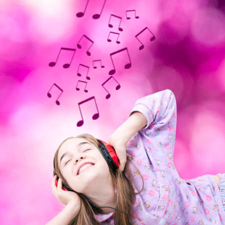 Young smiling listening to music with headphones photo