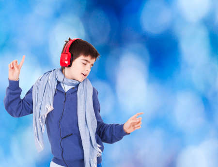 Young dancing with blue background and headphones photo