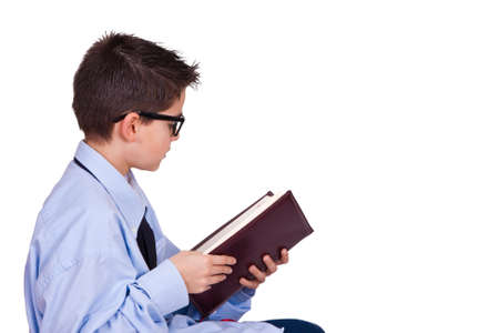 young man in business clothes reading the book photo
