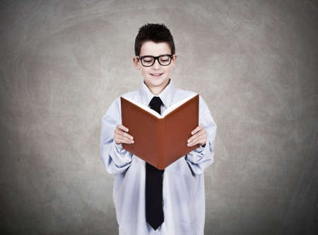 young man in business clothes with open book reading photo