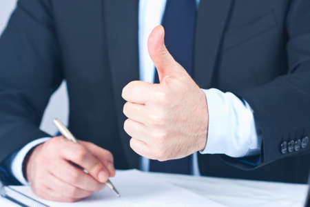 approval: Businessman with hand in approval and okay