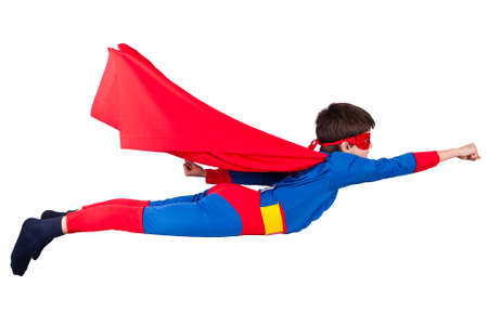 child dressed up as super hero with cape house production Stock Photo