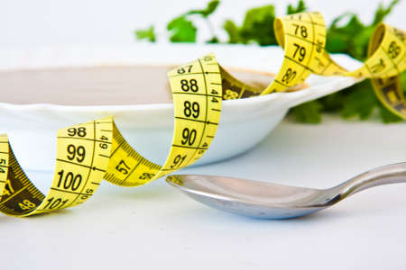 tape measure with healthy food to lose weight photo