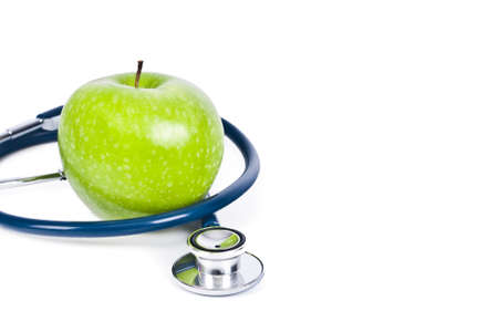 stethoscope and apple isolated on white background photo