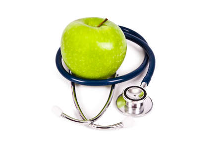 stethoscope and apple isolated on white background photo