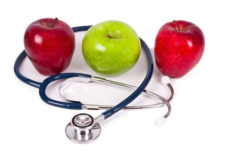 diet healthy: manzanas con estetoscopio concepto de dieta saludable Foto de archivo