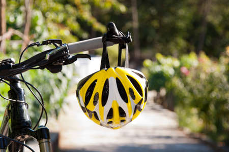 road cycling: cycling helmet closeup on bicycle outdoors