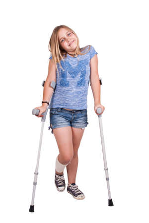 little girl with crutches isolated on white background Stock Photo - 32731597