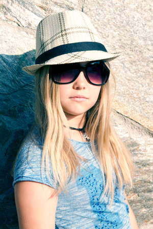 urbanite: Long-haired girl in hat and sunglasses, portrait
