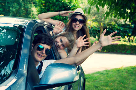 happy people traveling by car, vintage effect photo