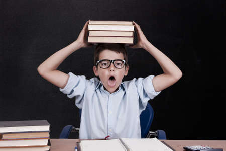 children s book: boy with books on the study table