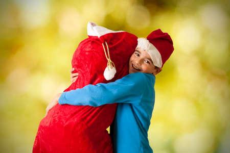 children s book: Children with sack of gifts santa claus