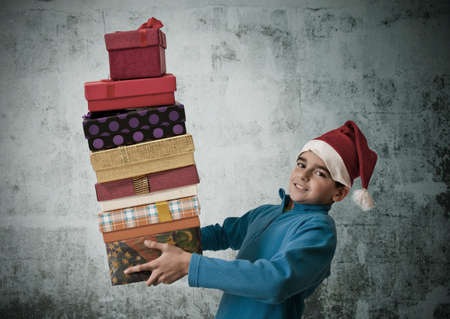 santa s bag: child with christmas gifts stacked