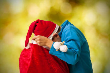 santa s bag: child looking for holiday gifts