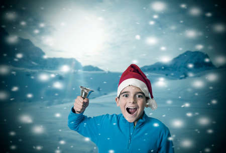 singing bells: children in the snow at christmas Stock Photo