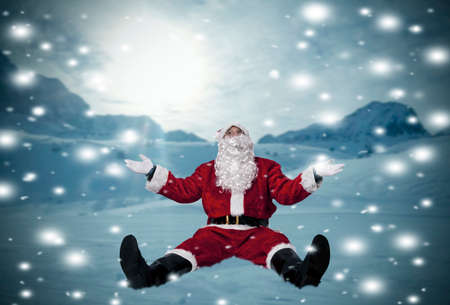 santa claus sitting in the snow at Christmas photo