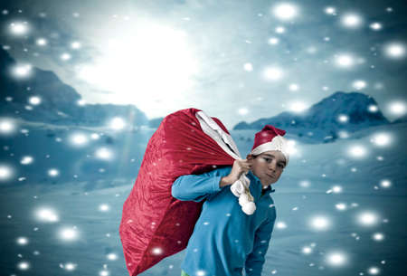 santa s bag: children in the snow at christmas Stock Photo
