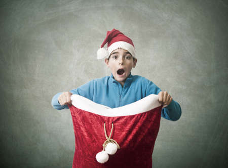 santa s bag: child with surprise christmas gifts