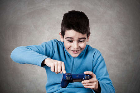 kids playing video games: boy playing video game Stock Photo