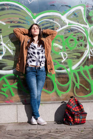 waiting posture: Young latina girl in the street sunbathing