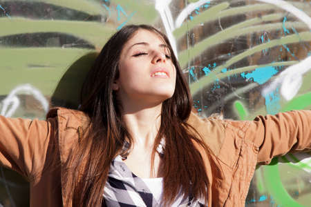 drowsiness: Young latina girl in the street sunbathing