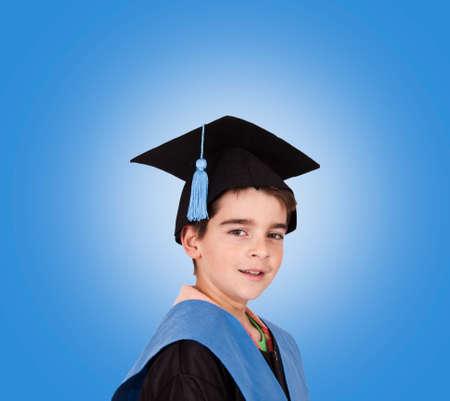 child with graduation robe Stock Photo