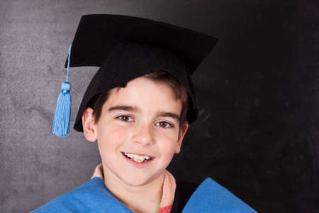 naughty or nice: child with graduation gown isolated