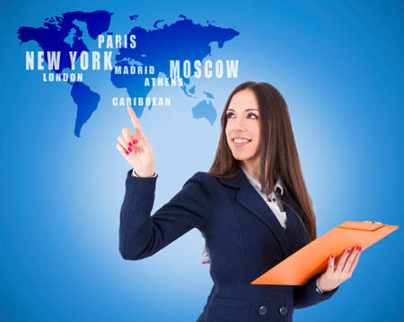 destinations: business woman pointing destinations on the map Stock Photo