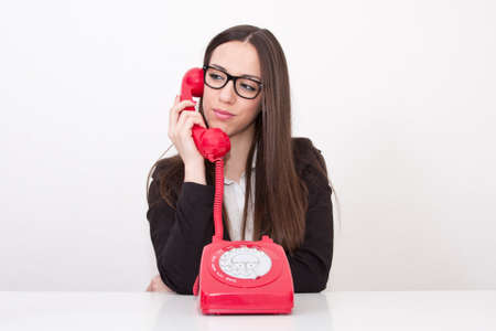 emergency call: business woman at the office table Stock Photo