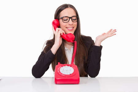 phone cord: Business woman talking on the phone cord Stock Photo