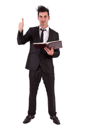 spiked hair: Man suit and book with symbol ok Stock Photo