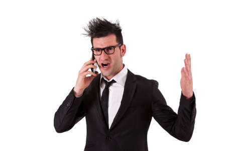 man scolding: angry man in a suit talking on mobile phone