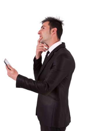 man in suit and tablet thinking Stock Photo