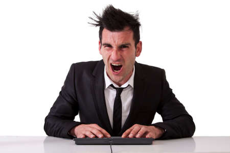 typing man: angry businessman Stock Photo