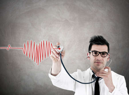 doctor with stethoscope and heart photo