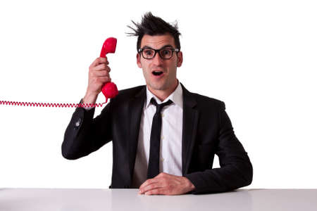 outraged: surprised businessman with red phone