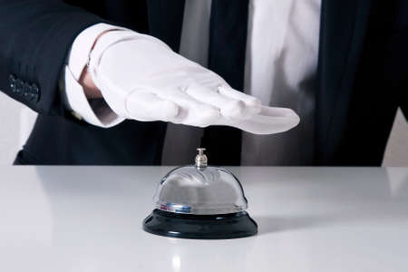 hospitality staff: butler bell Stock Photo