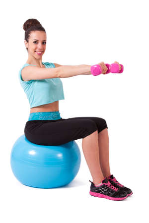 pesas: chica con pelota y pesas Foto de archivo