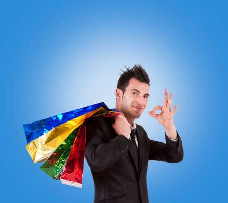 compras compulsivas: hombre con bolsas de la compra Foto de archivo