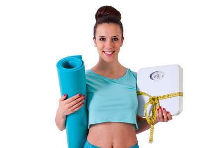 girl athlete with tape measure, scales and mat Stock Photo