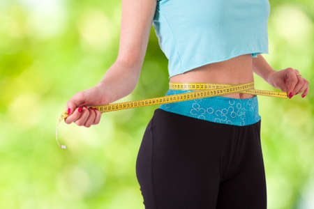 weight scales: concept of losing weight with sport Stock Photo