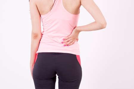 dolor espalda: Chica con dolor de espalda  Foto de archivo