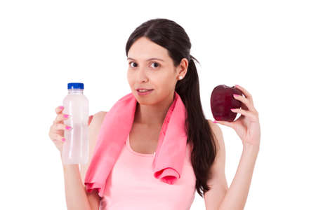 sportwoman: girl playing sports with apple and water bottle