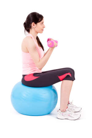 gym ball: girl lifting weights in gym ball