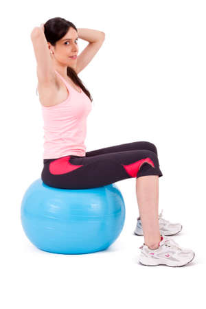 crunches: girl doing crunches on fitness ball