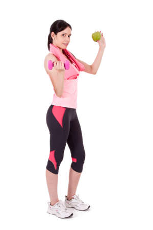 sportwoman: Girl with dumbbells and apple
